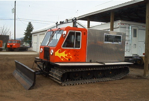 "1975 Bombardier 250, 6 cyl., AT., 6-way front blade, full custom cab, 41"" tracks, low hours, custom paint."